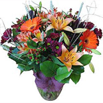 This exquisite bouquet will warm your loved one's heart - rain, snow or shine! Our local florists skillfully select the warmest-hued bloom for this arrangement, starting with Asian lilies in pink tones, gerberas in sunny orange and other complementing seasonal flowers. The bouquet is accented by luscious greens. Each bloom is hand-selected for its superior quality: available anywhere in Russia and former USSR