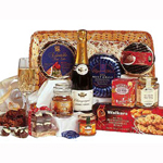 Holiday basket with bottle of imported holiday champagne, imported quality coffee, 2 boxes of delicious assorted cookies, 3 boxes of variety chocolates, jam, dried fruits and packaged nuts.
